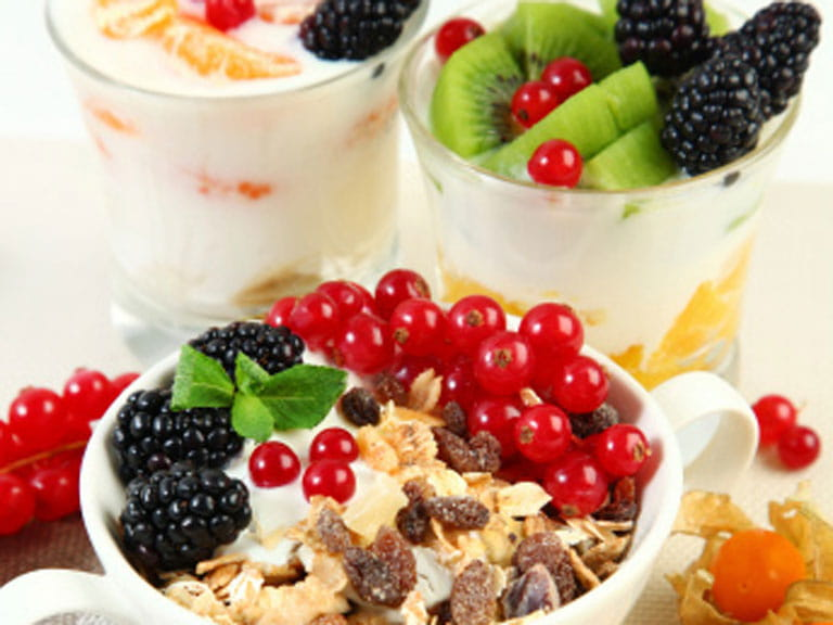 Yogurt with muesli and fresh fruit.