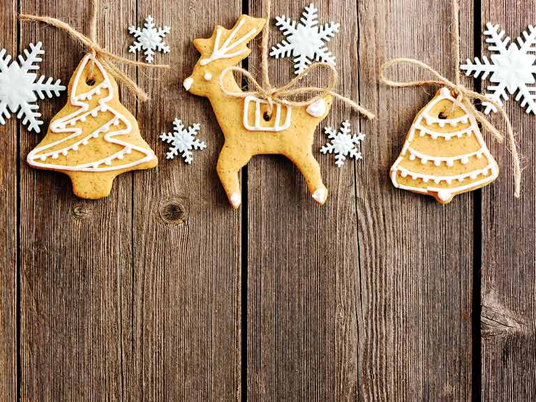 Reindeer and christmas tree shaped festive biscuits