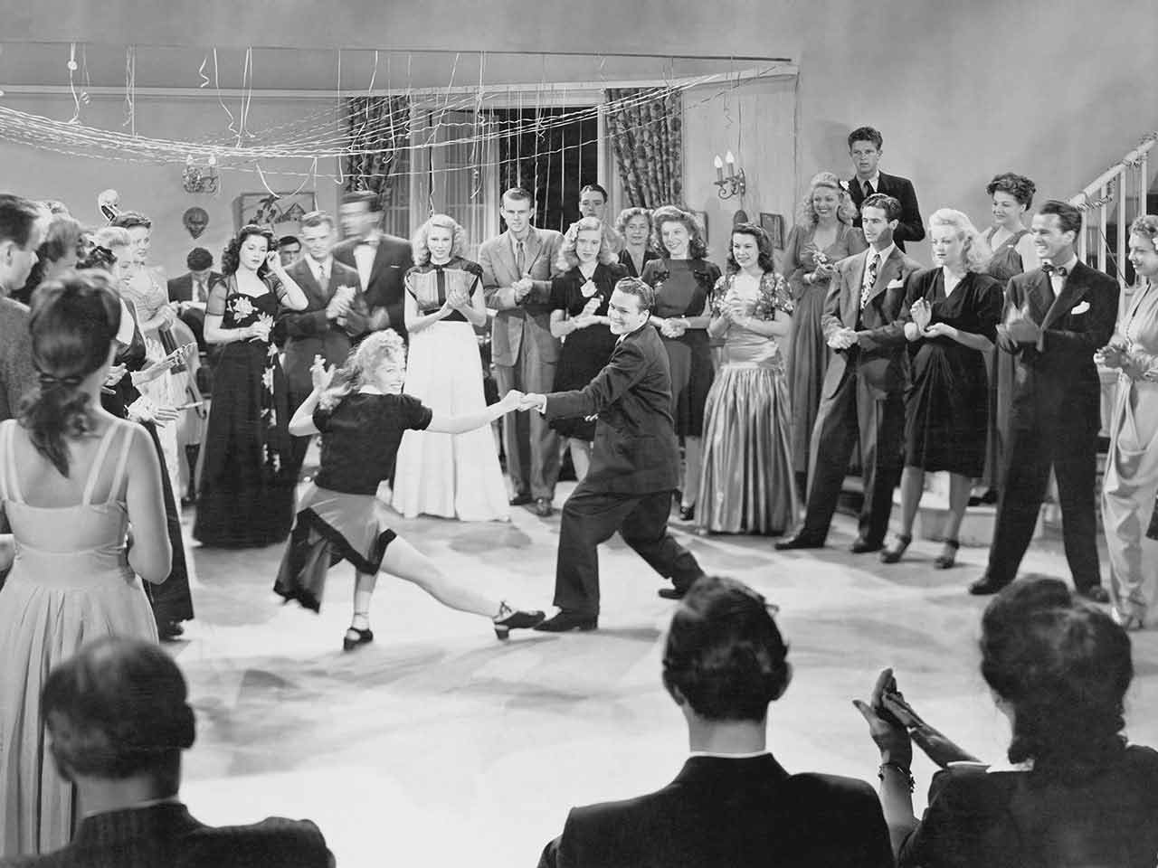 A couple swing dancing, a type of dance from the 1940s