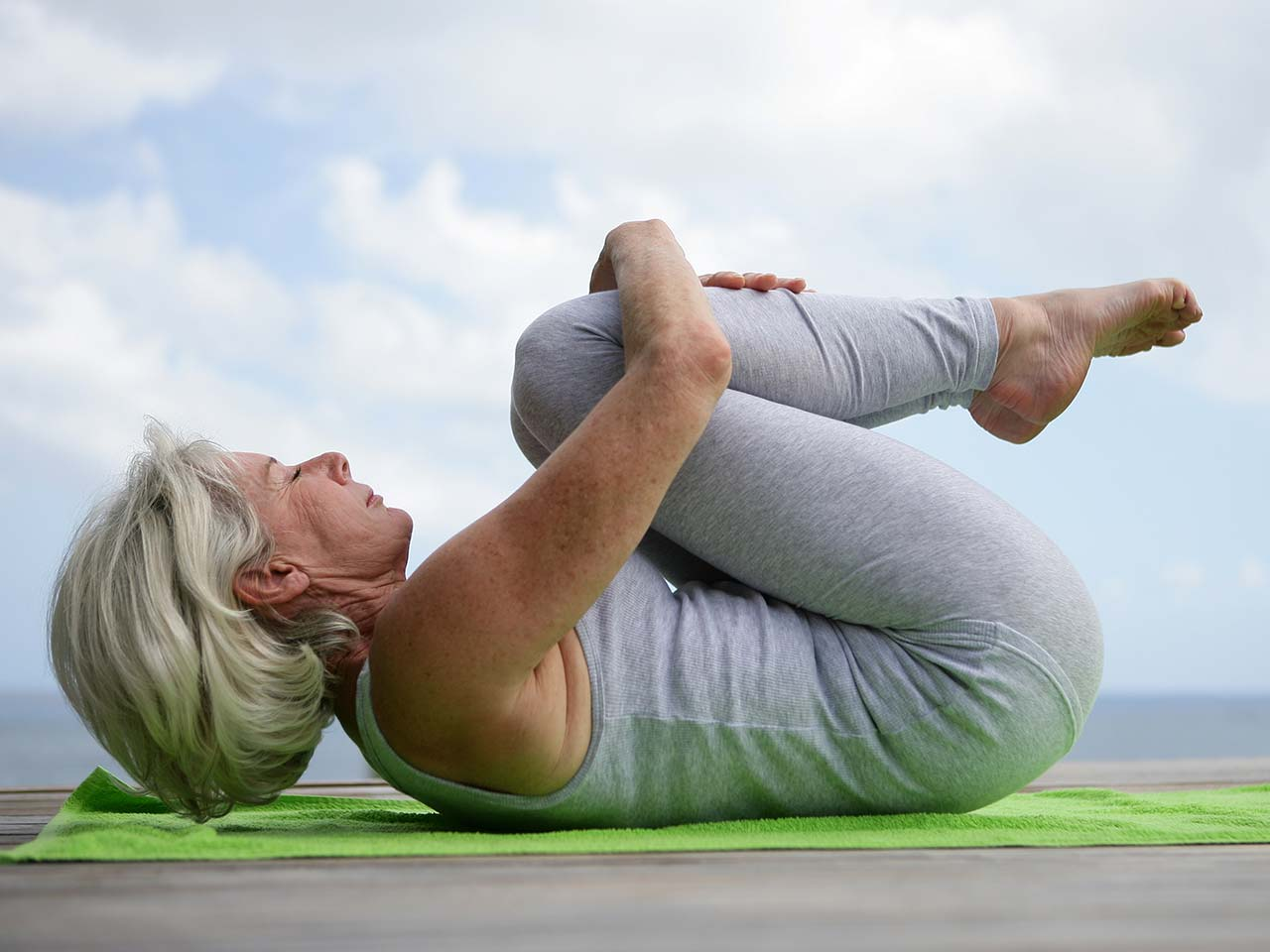 Older woman in yoga pose