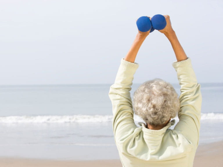 Older woman doing exercises at home