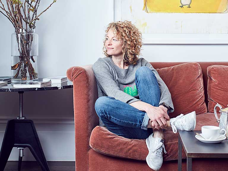 TV presenter and author Kate Humble relaxing on a sofa