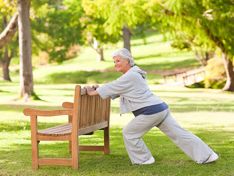 Older woman performing stretching exercises