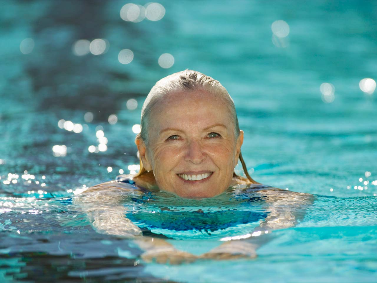 Woman swimming for fitness