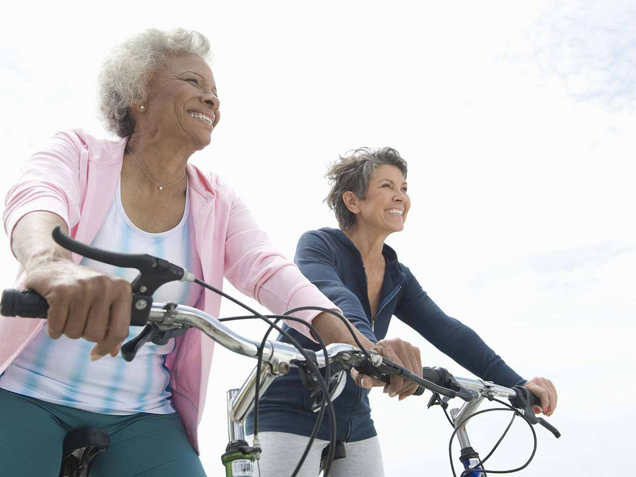 Two senior friends riding bikes