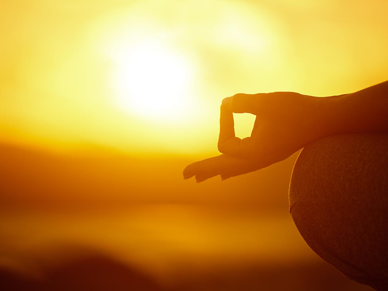 Silhouette of woman in yoga zen pose