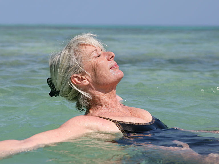 Mature woman swimming in the sea