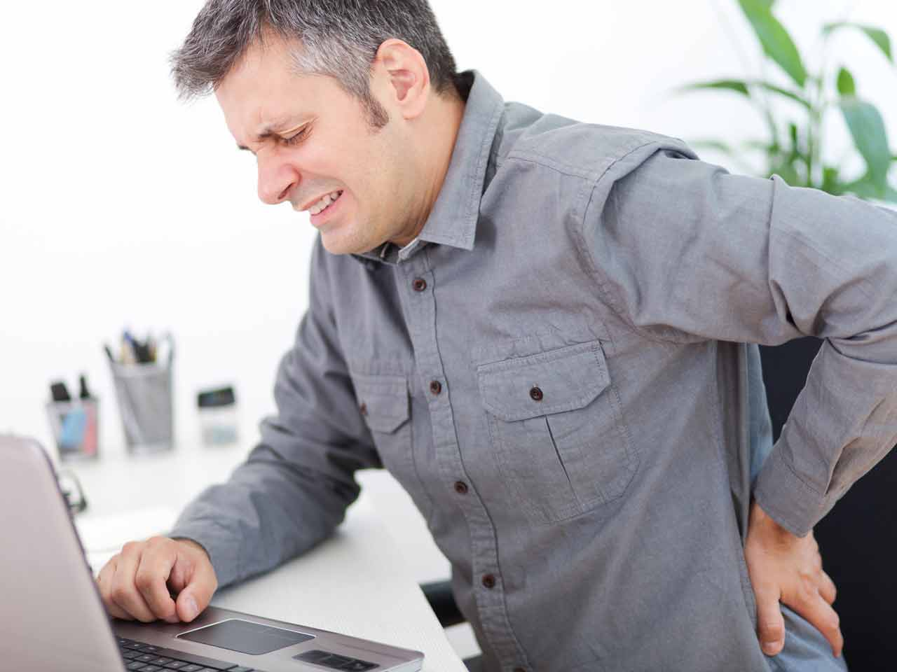 Office worker experiencing back pain