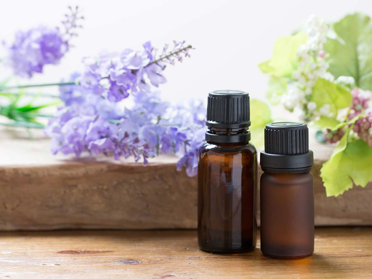 Aromatheraphy bottles on wooden table