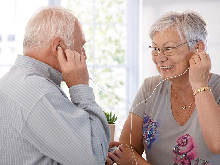 Senior couple listening to mp3 player