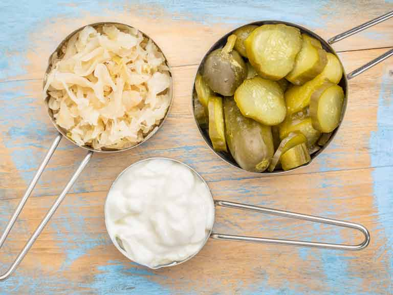 sauerkraut, cucumber pickles and yogurt - popular probiotic fermented food