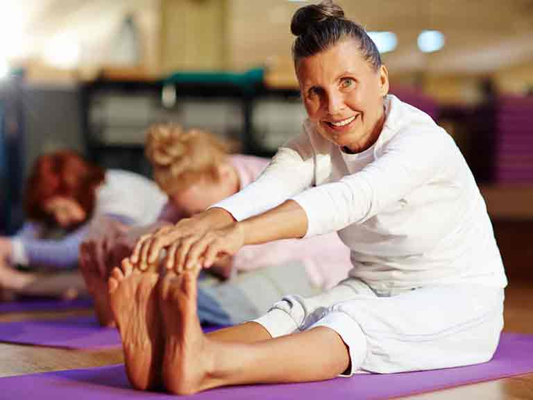 Woman stretching in yoga class