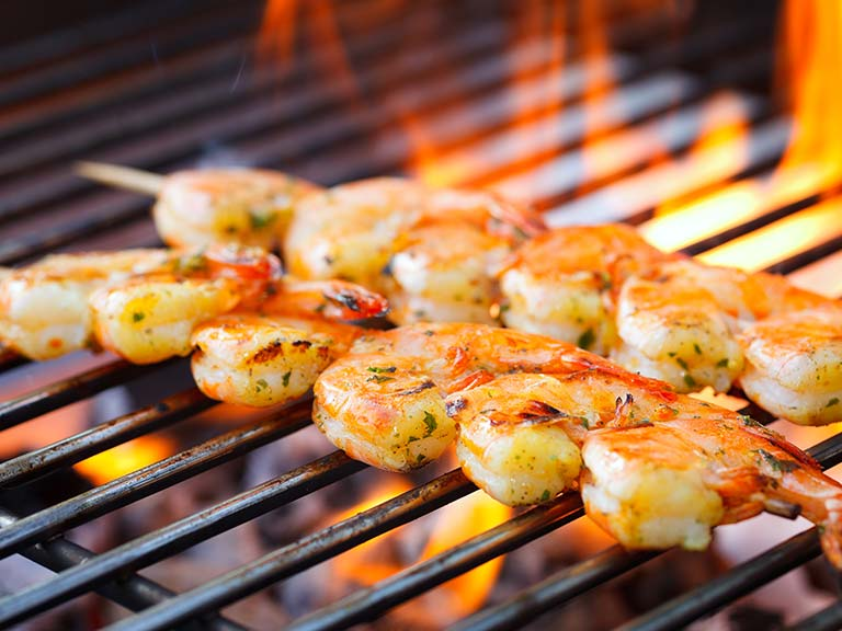 Grilled prawns on a barbecue