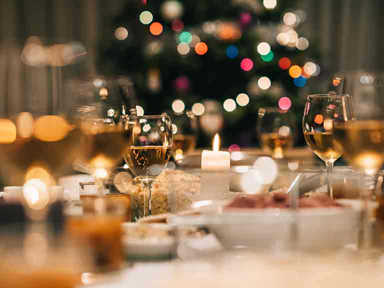 A table set for Christmas dinner, with wine glasses