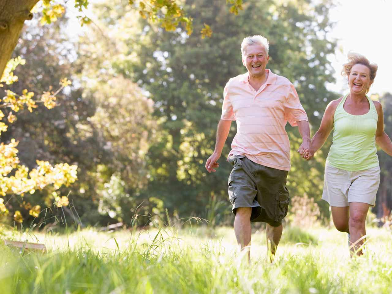 Mature couple running and laughing