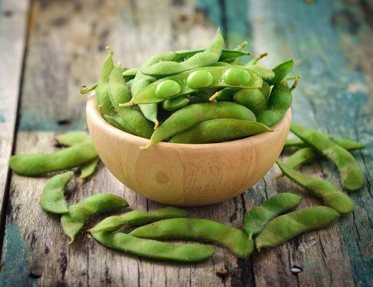 Soya foods, like these green soy beans, may help ease menopause symptoms
