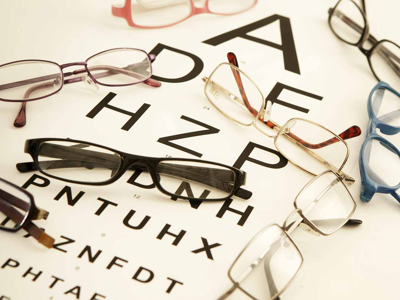 Pairs of glasses on an eye test chart