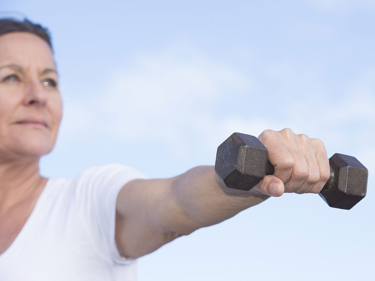 Mature woman working out with hand weights