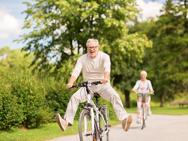 A older couple ride bikes - in a possible attempt to live to over 100