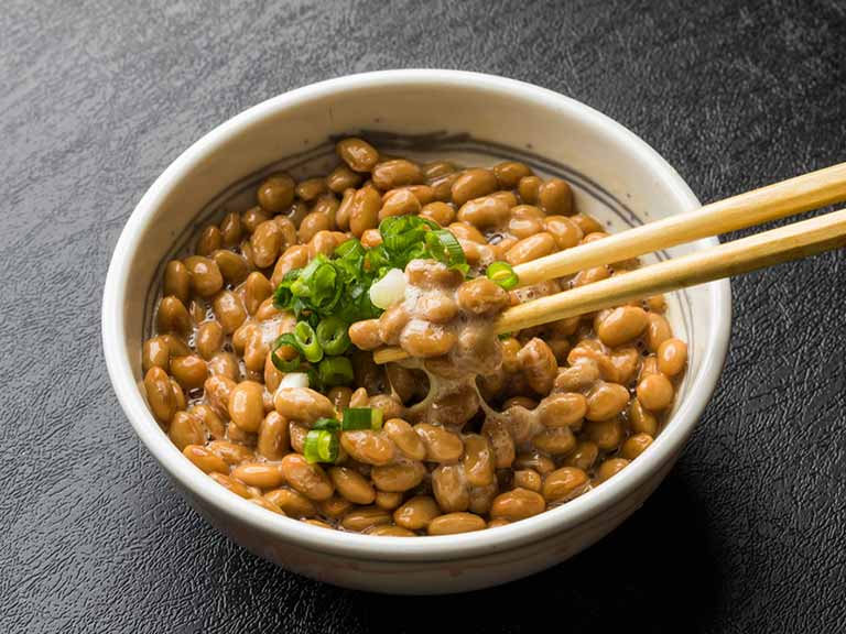 Natto, a Japanese food made from fermented soya beans, is one of the richest sources of vitamin K2.