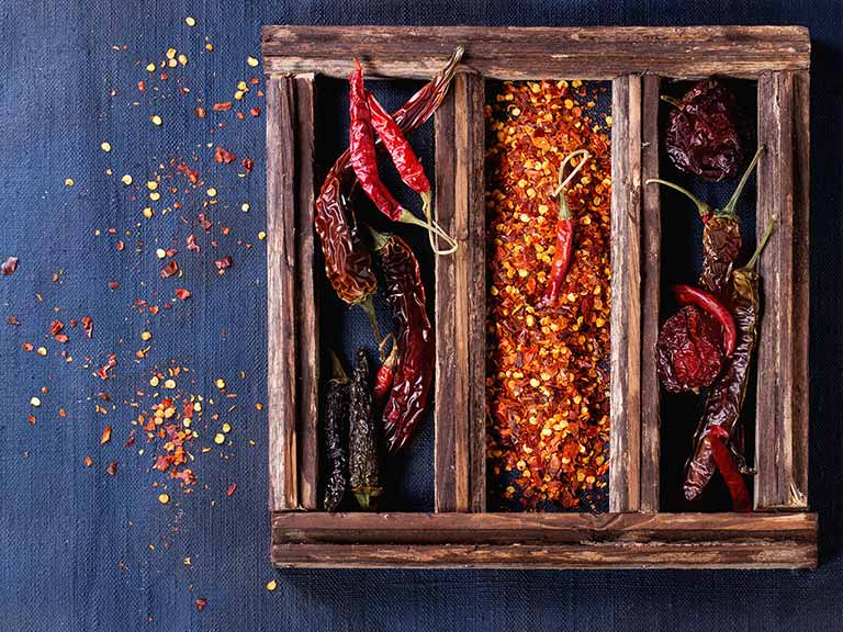 Chili peppers in a wooden box
