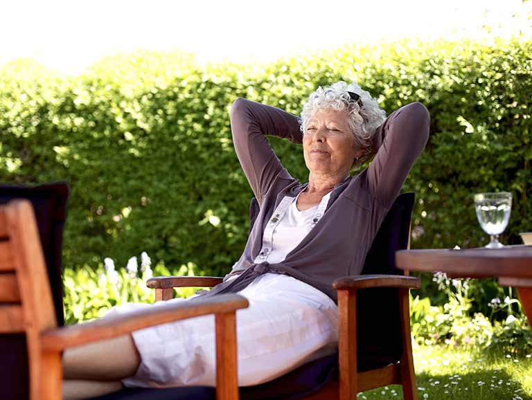 Senior relaxing in garden
