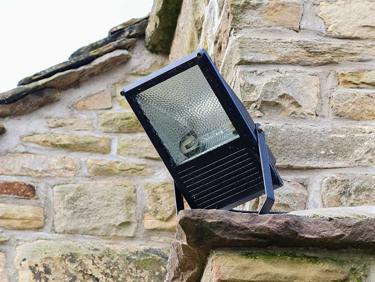 Outdoor security light on the side of a house