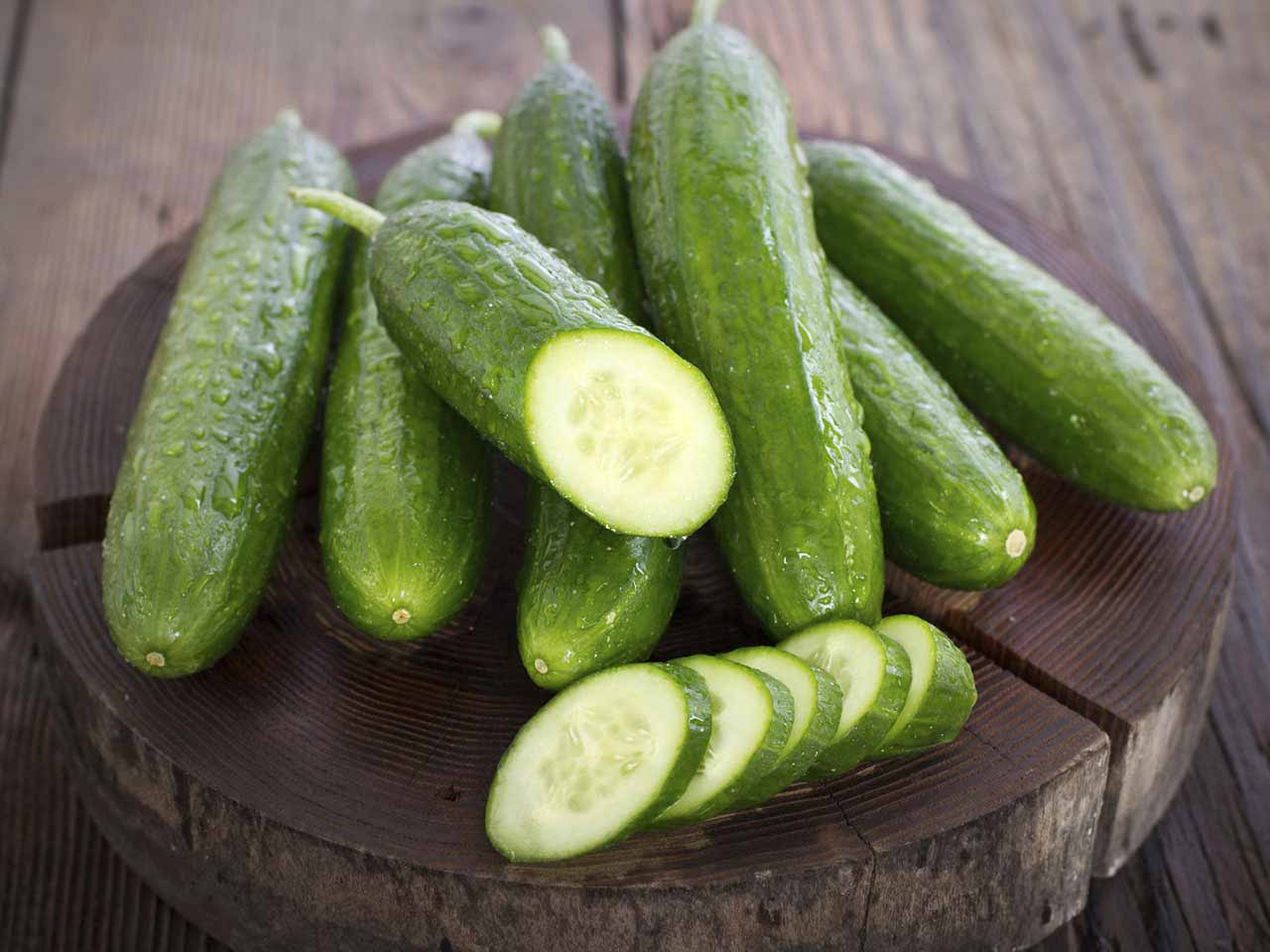 Cucumbers on wooden preparation board