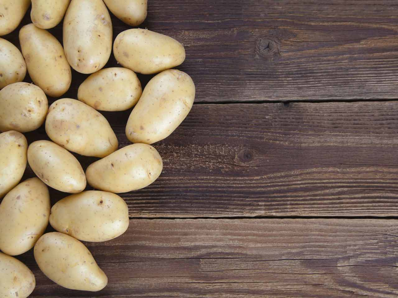 Potatos on  a wooden preparation board
