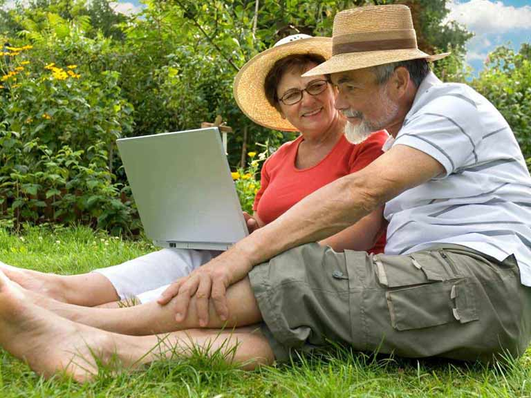 Couple designing a garden on a computer