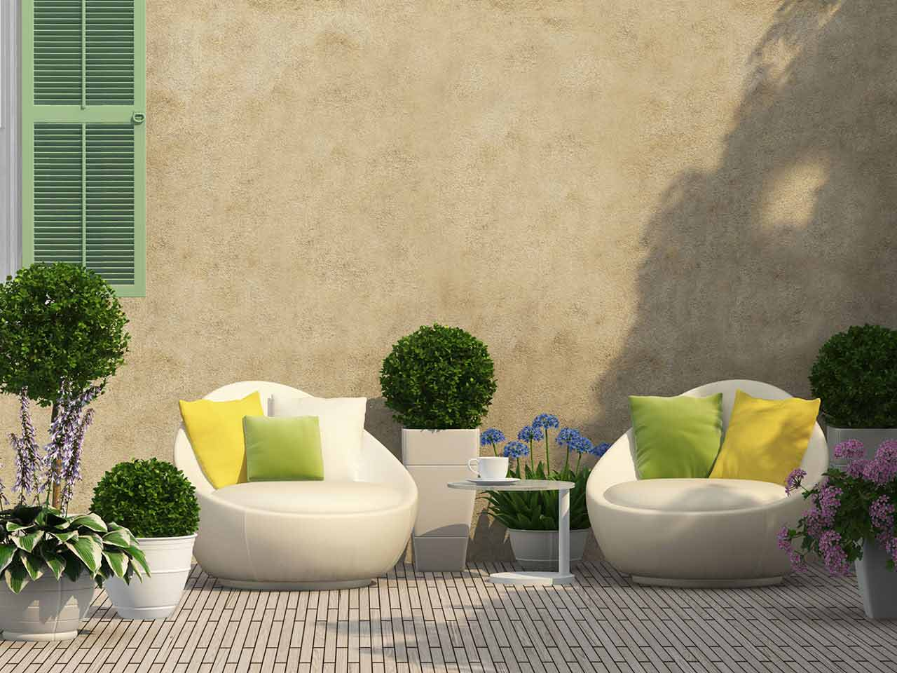 Courtyard garden with furniture and topiary
