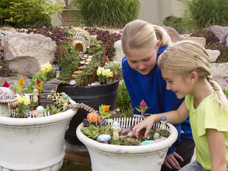 Children with miniature fairy gardens