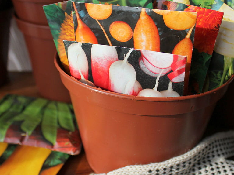 Seed packets in a flower pot