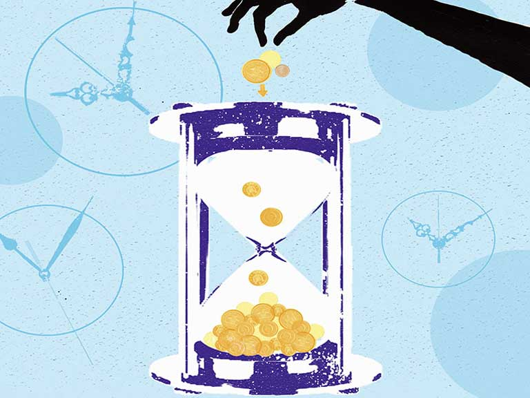 Money going into an egg timer to represent investing for the future