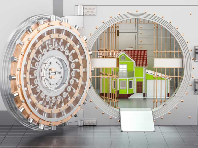 Unlocked bank vault with a house inside