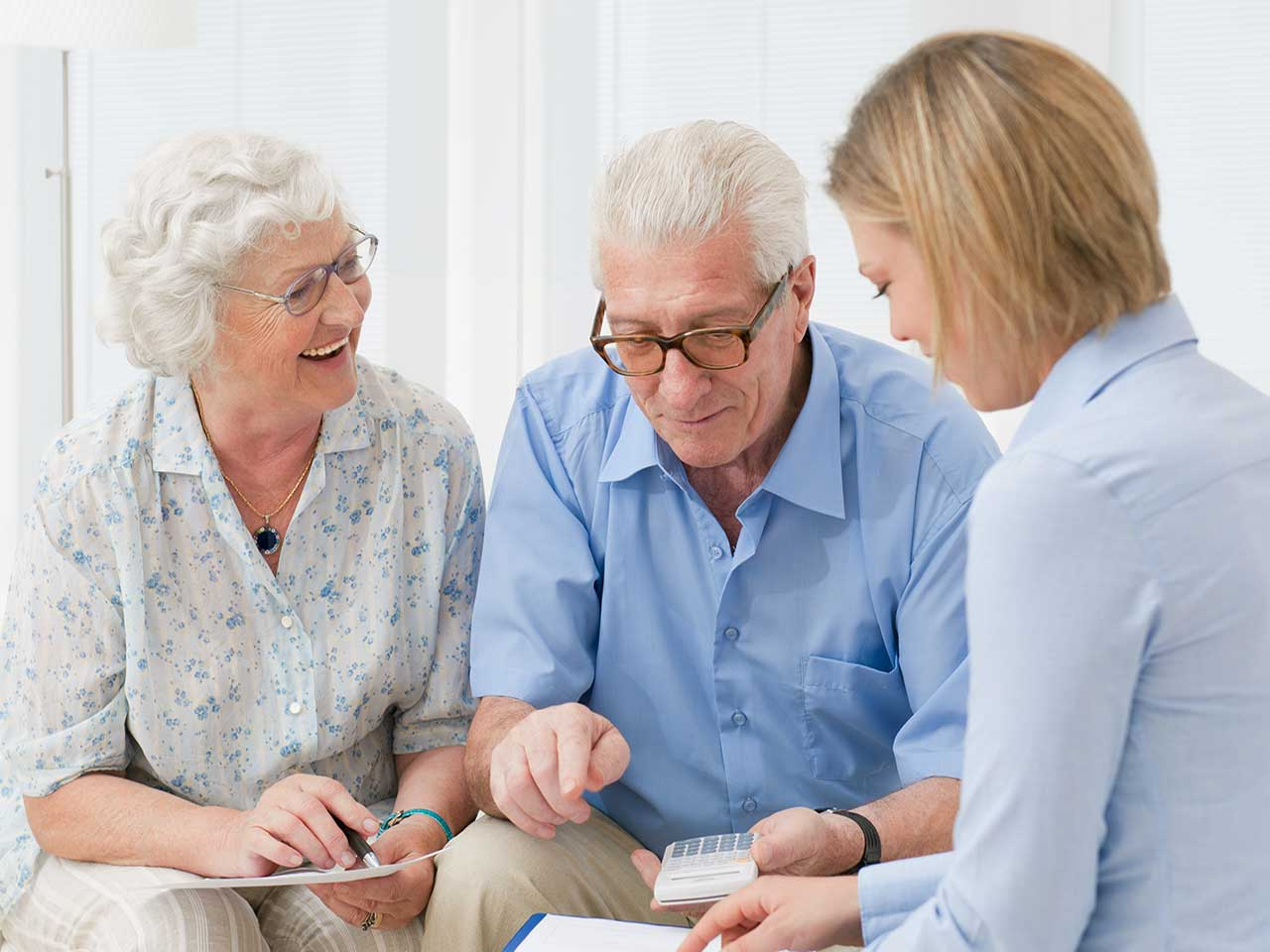 Mature couple seeking advice from a financial advisor