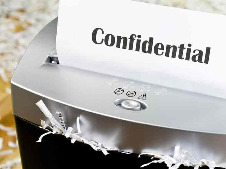 Shredding confidential paperwork