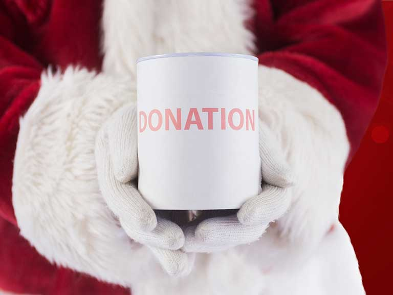 Santa with a charity collection tin at Christmas
