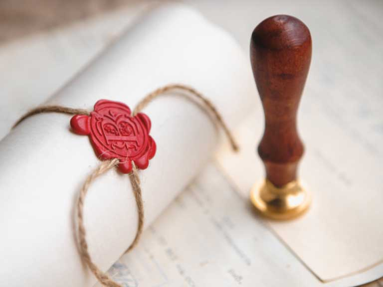Legal document tied with string and secured with a wax seal
