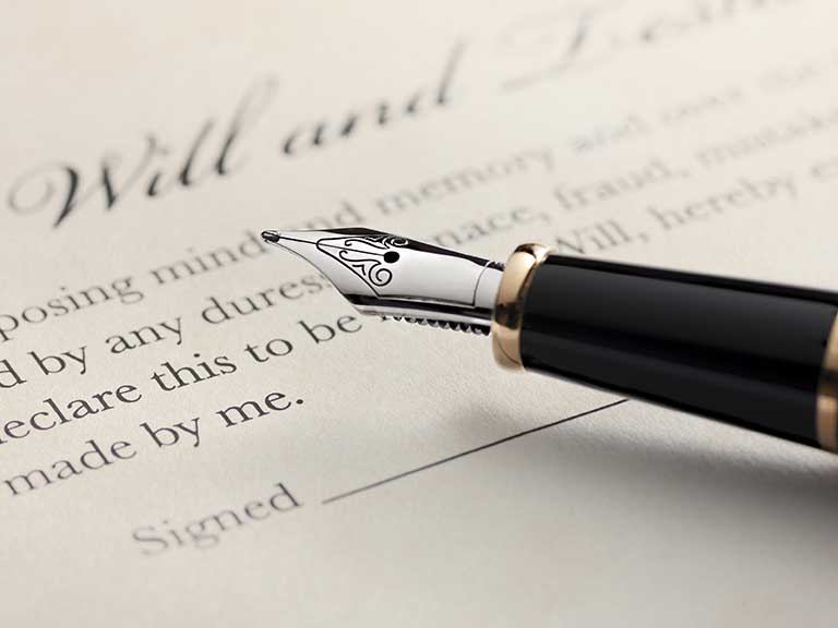 A pen rests on a Will