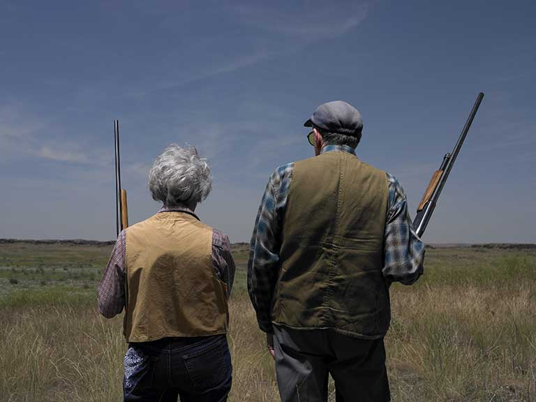 Couple with shotguns