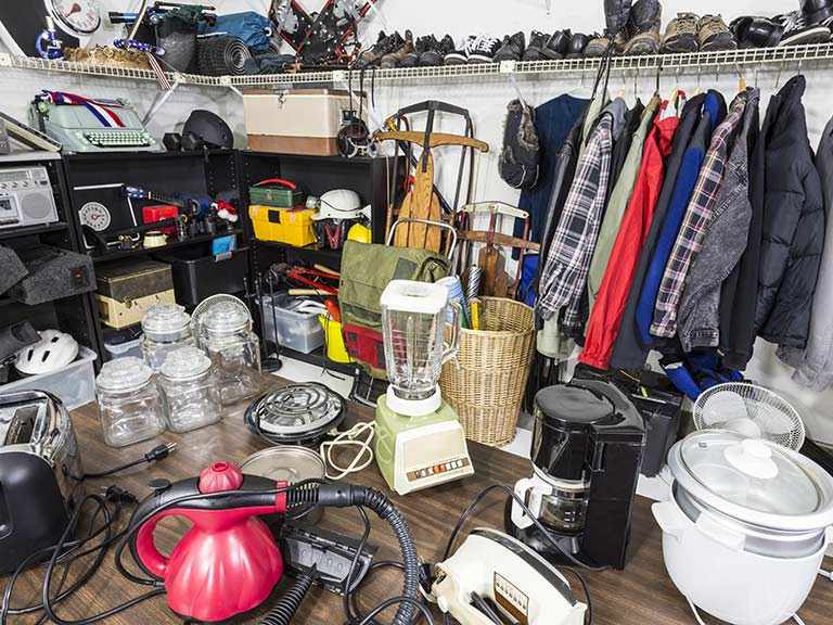 A cluttered garage full of items that could be sold