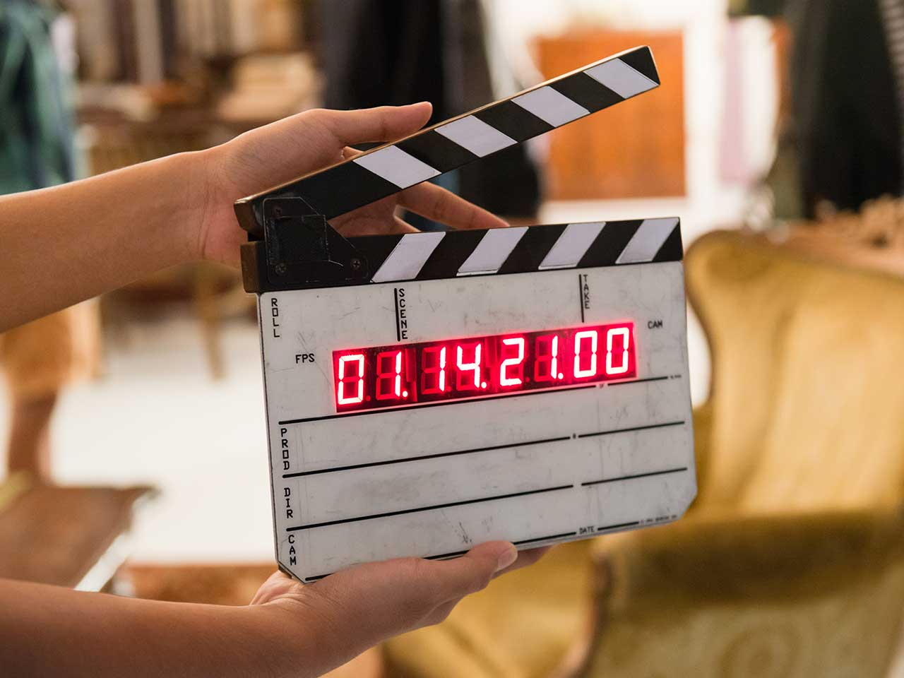 Film clapper board inside a home location