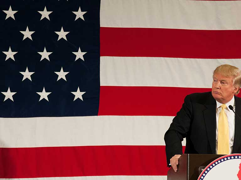 Donald Trump in front of the American flag in the USA
