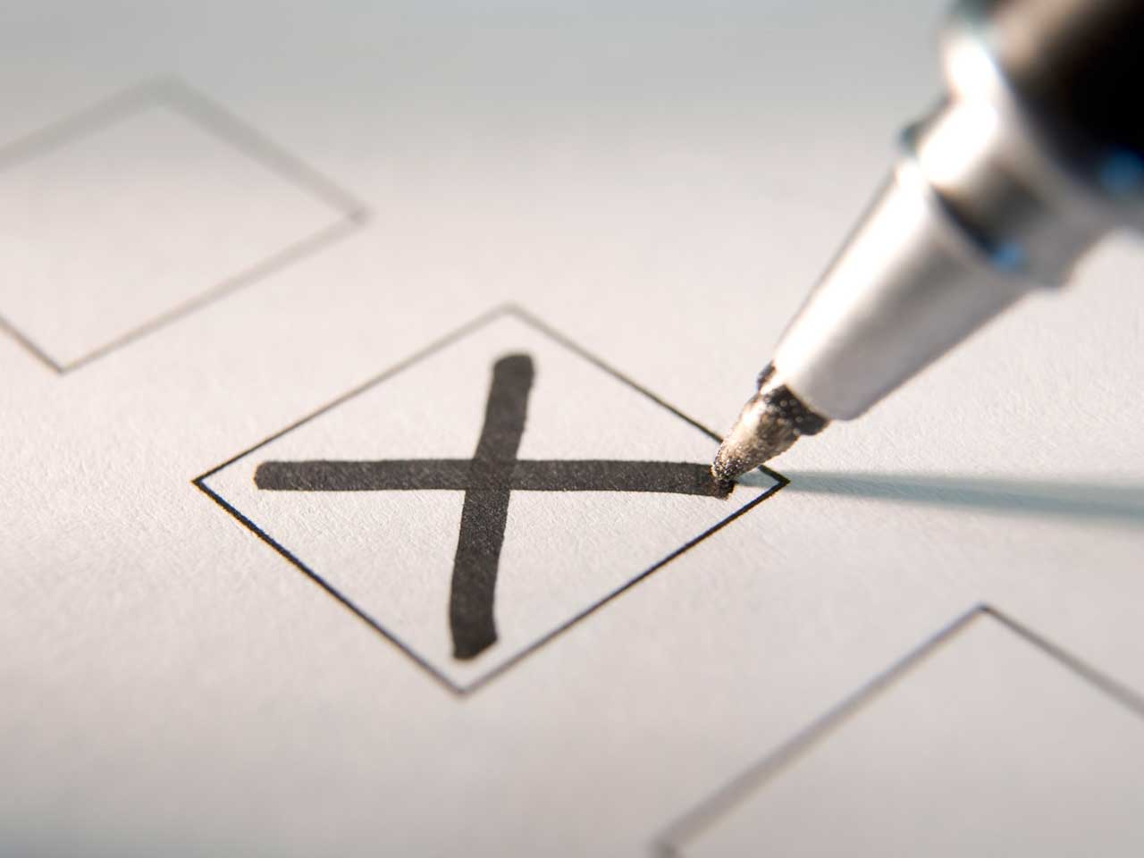 Ballot paper with pen marking a cross