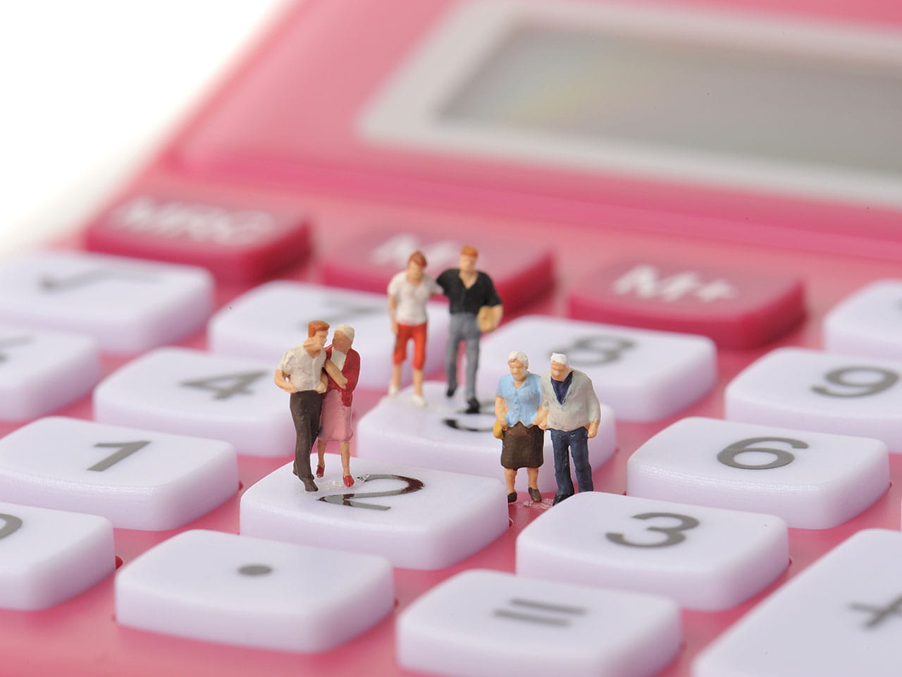 Model figures standing on calculator denoting budget update