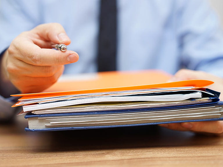 Accountant holding tax files