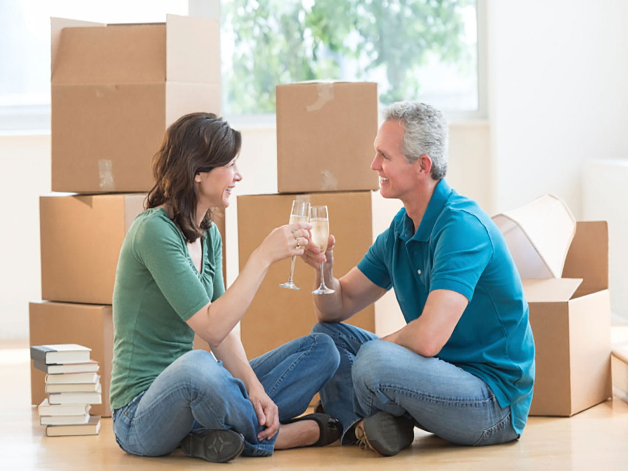 Couple sat in front of moving boxes