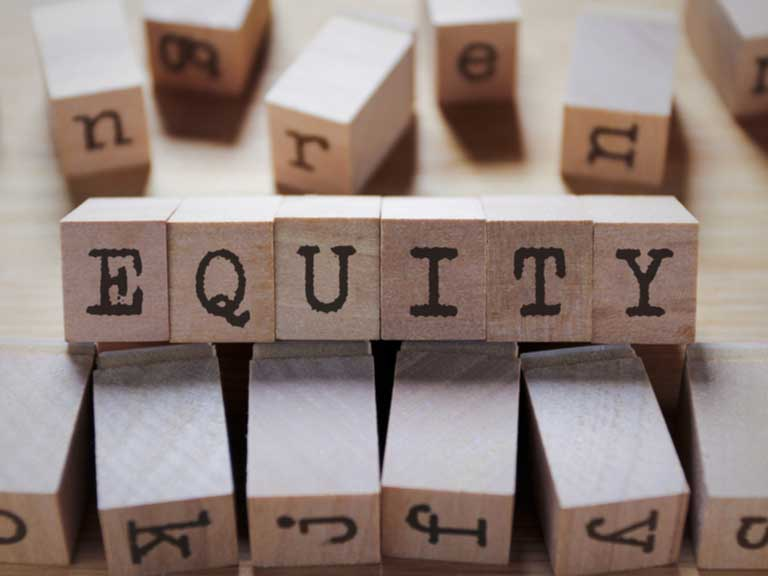 The world Equity spelled out in wooden blocks