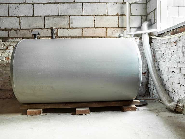 A metal oil heating tank needing repair